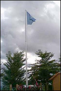 The UNICEF flag against a cloudy Malian sky